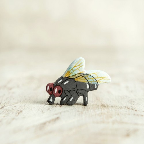 Wooden fly figurine