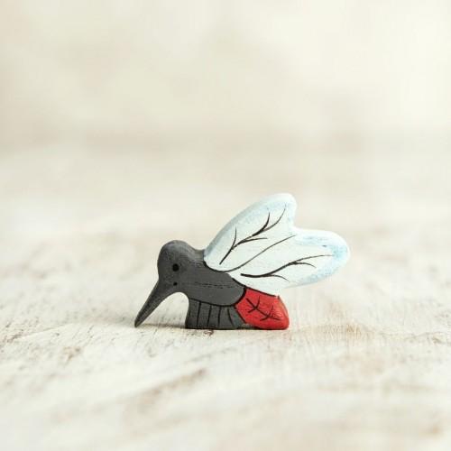 Wooden mosquito figurine
